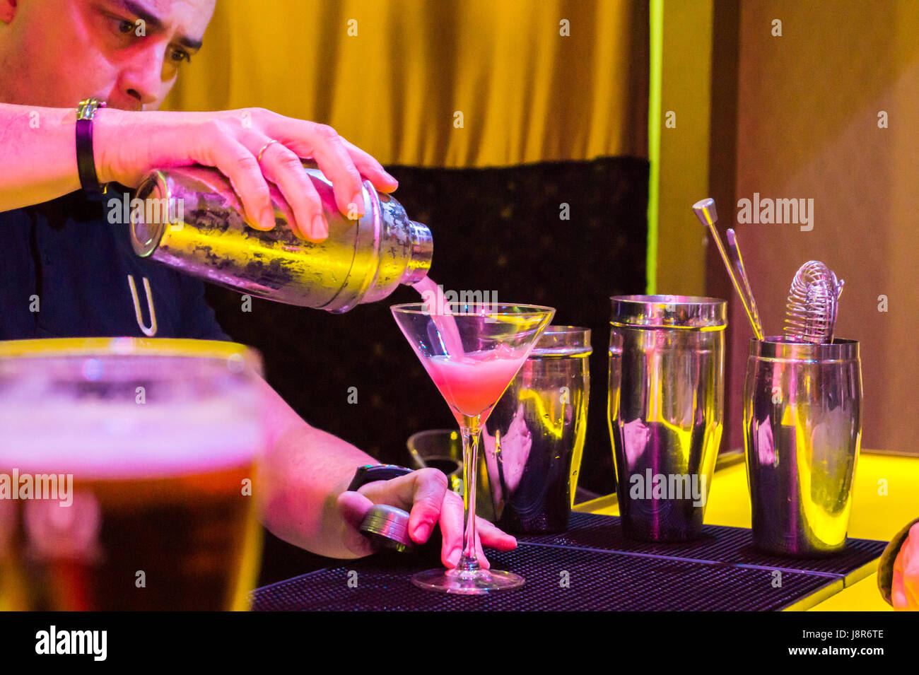 Barman pouring a Cosmopolitan cocktail at Urban Cocktail Club bar, Oviedo Asturias Spain Stock Photo