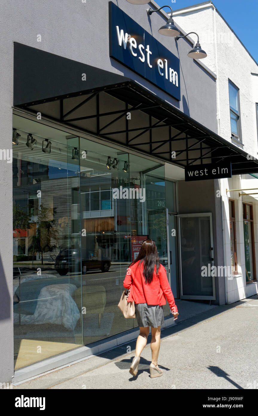 young-woman-walking-past-a-west-elm-home