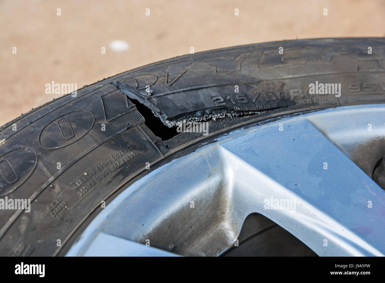 Damaged Car Tyre Stock Photo