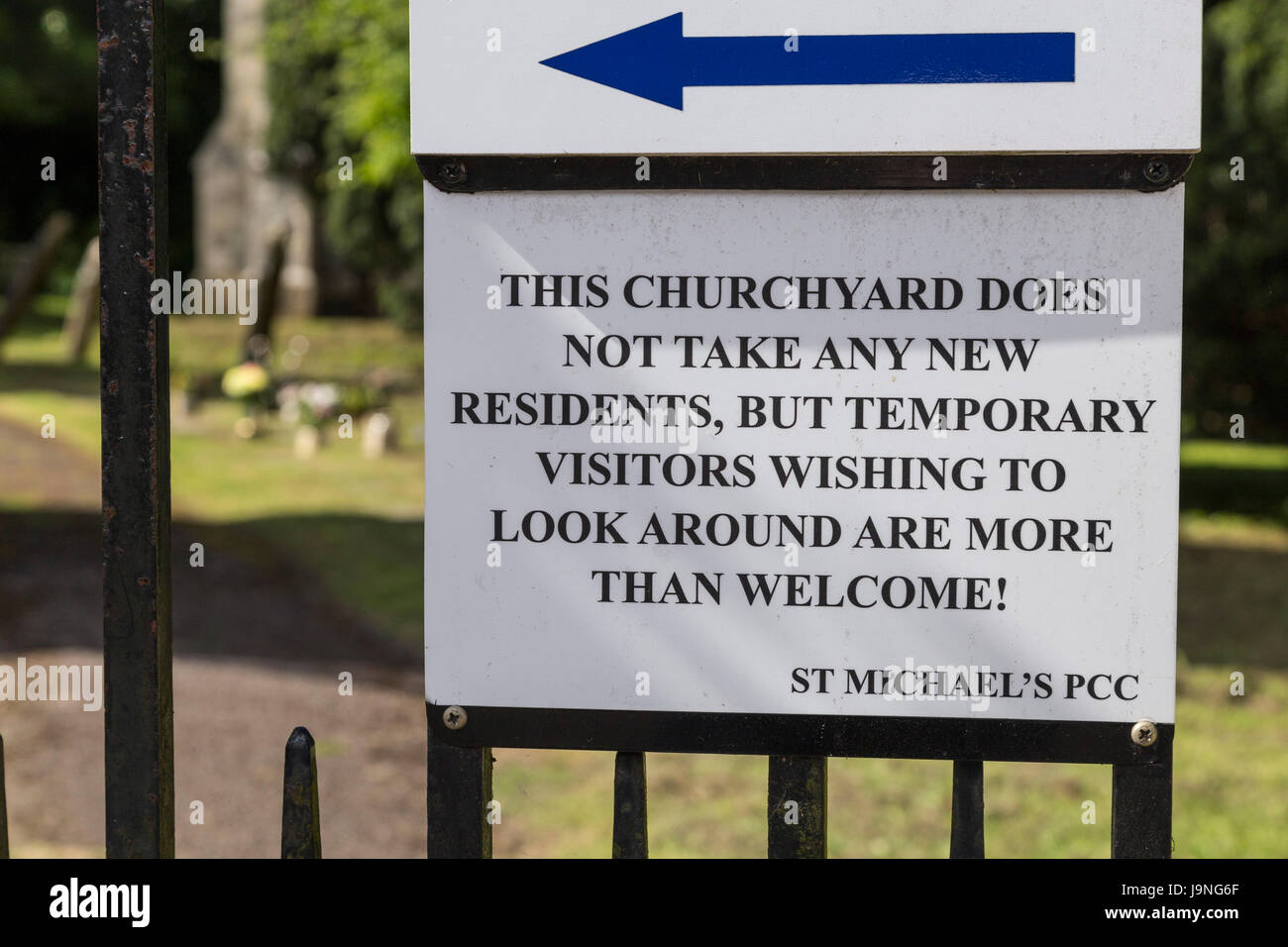 Amusing graveyard sign in Beer, Devon. Funny cemetery notice. Stock Photo