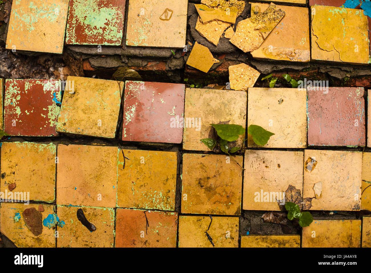 Cracked retro old tiles floor background texture vintage color cracked retro old tiles floor background texture vintage color dirty broken tile dailygadgetfo Choice Image