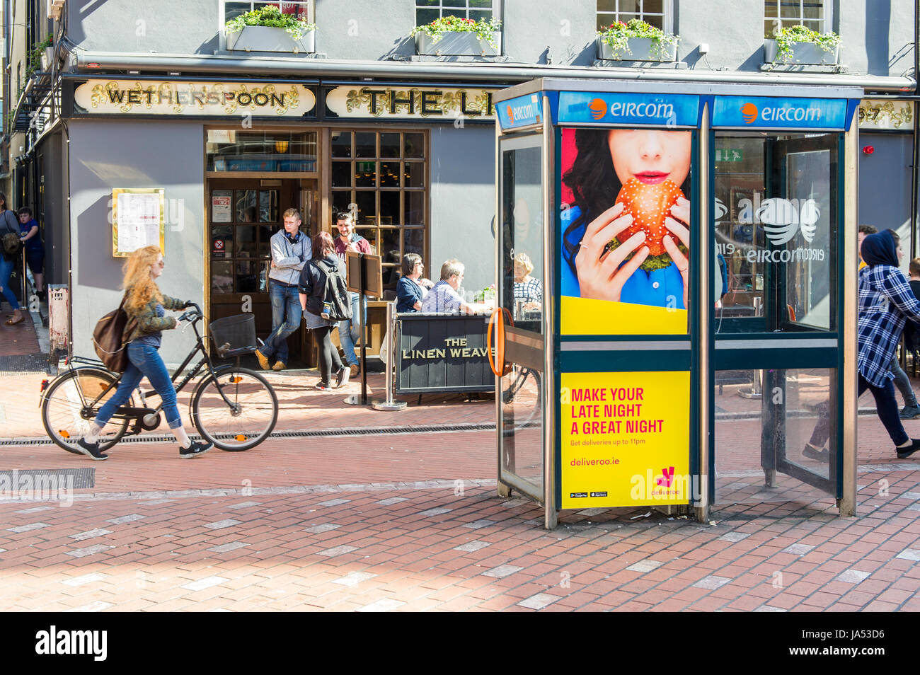 deliveroo-advert-on-a-public-telephone-phone-box-in-cork-ireland-with-JA53D6.jpg