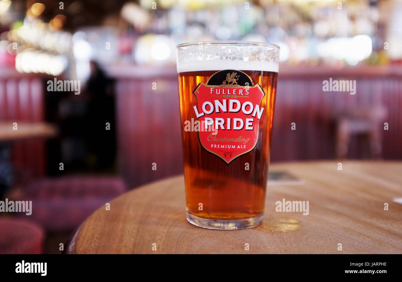 Pint of Fullers London Pride Best Bitter beer in British pub Stock Photo