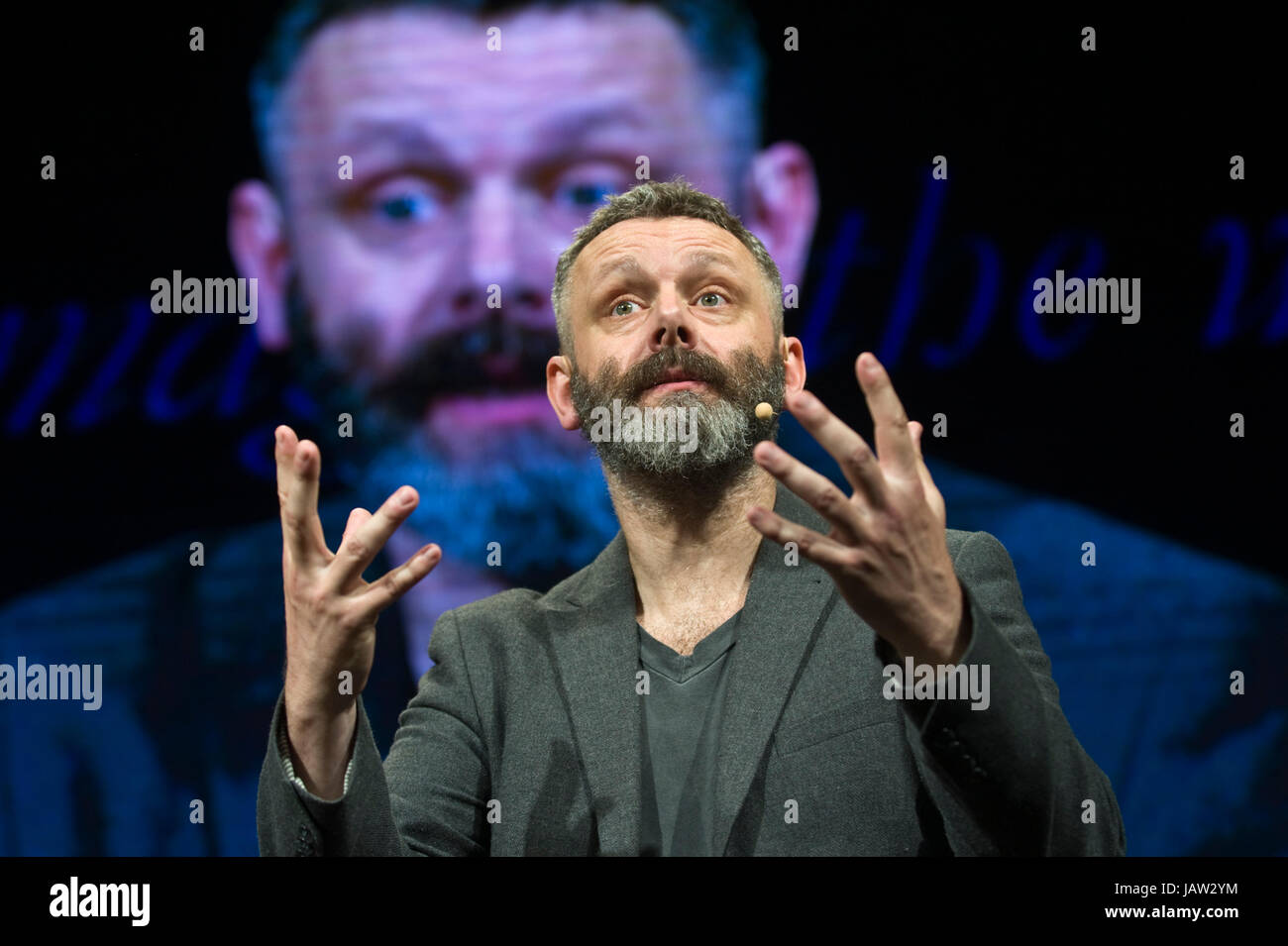 michael-sheen-actor-giving-the-aneurin-bevan-lecture-on-stage-at-hay-JAW2YM.jpg