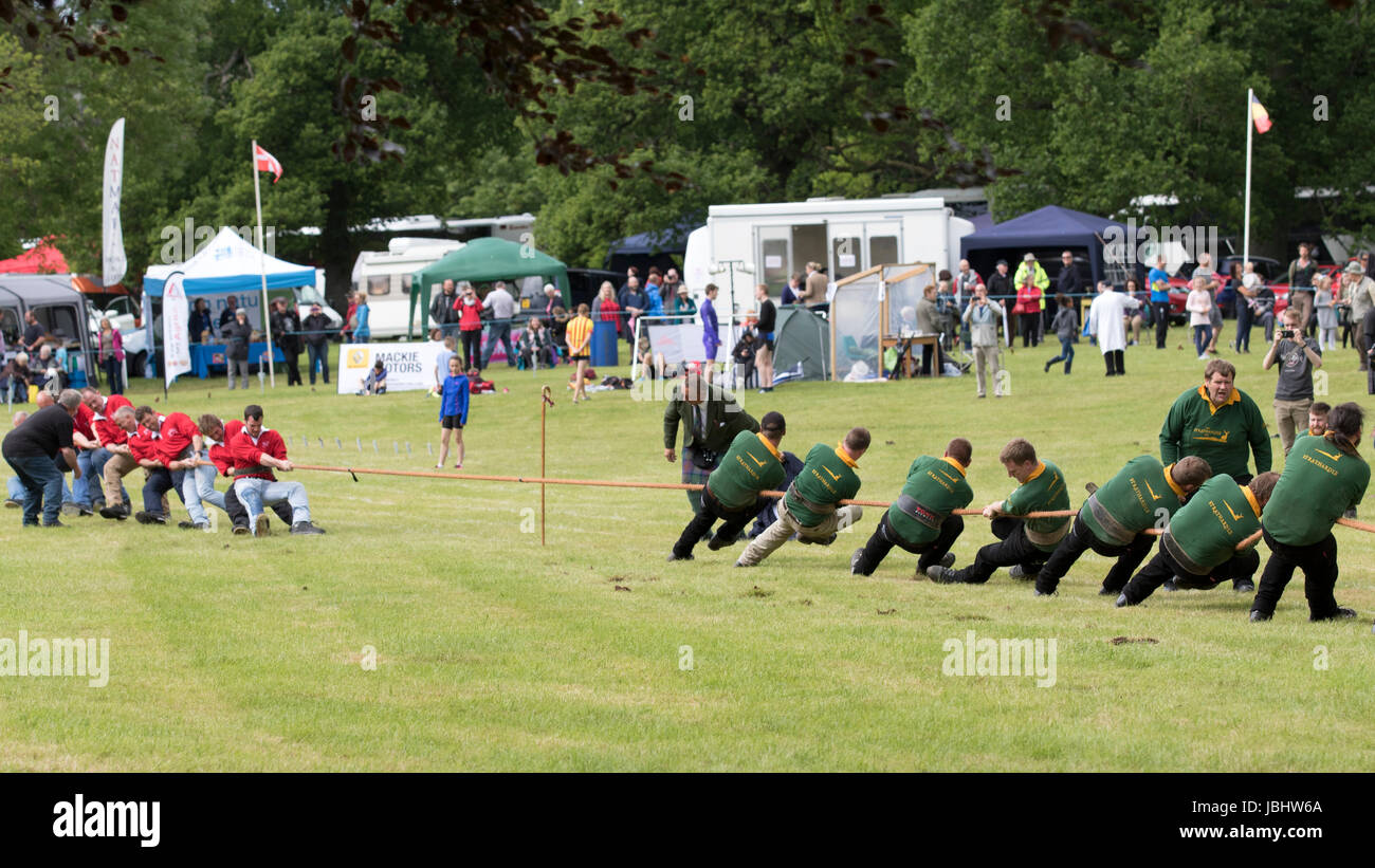 Glamis, Scotland - Jun 11, 2017: A tug of war contest during the Strathmore Highland Games event at Glamis Castle Stock Photo