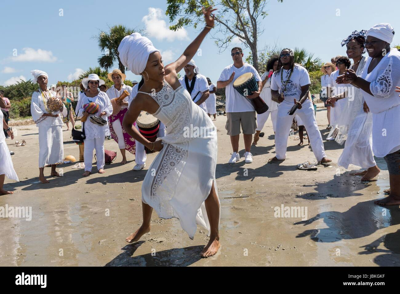 Descendants of enslaved Africans brought to Charleston in the Middle Passage dance to honor their relatives lost Stock Photo