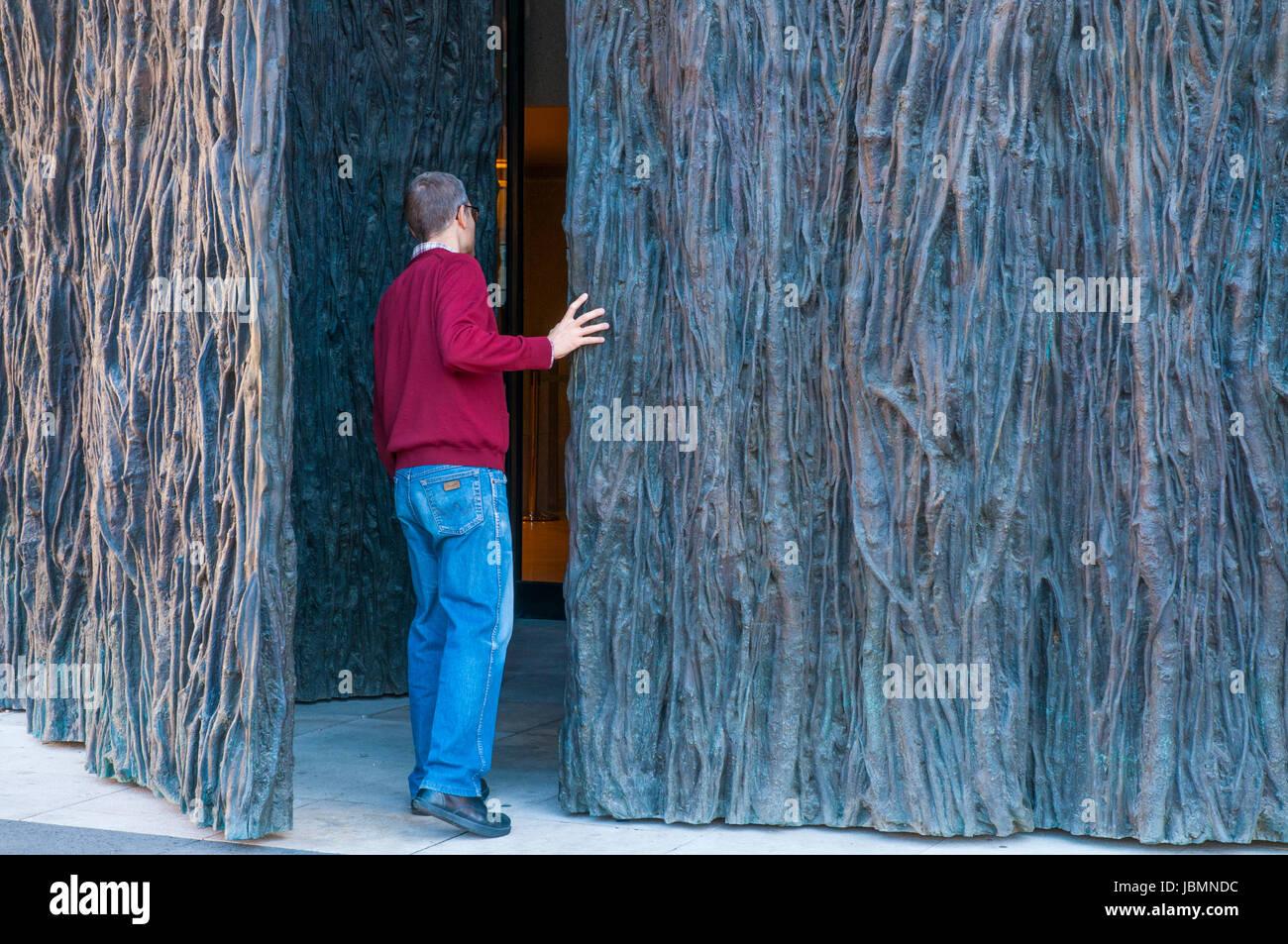 Man Looking Inside A Place Through An Open Door
