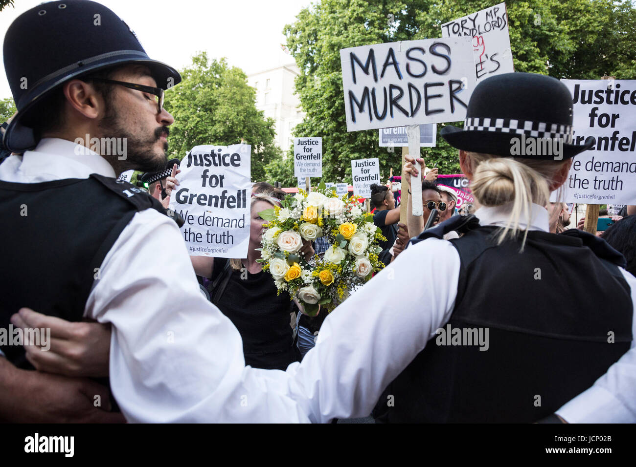 London, UK. 16th June, 2017. Justice for Grenfell Protest outside Downing Street. Protesters call for a full investivation Stock Photo