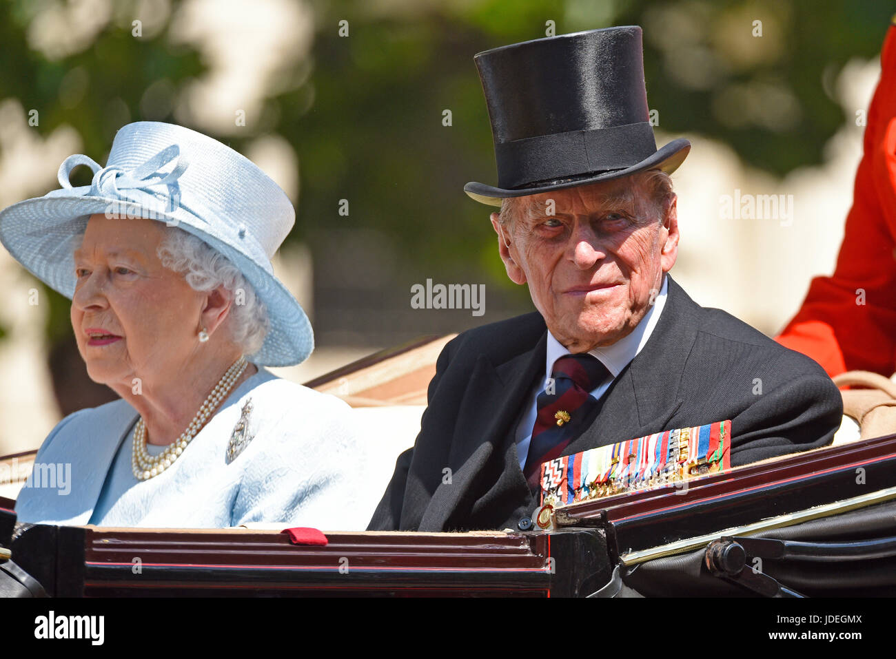 the-queen-and-prince-philip-in-a-carriage-during-trooping-the-colour-JDEGMX.jpg