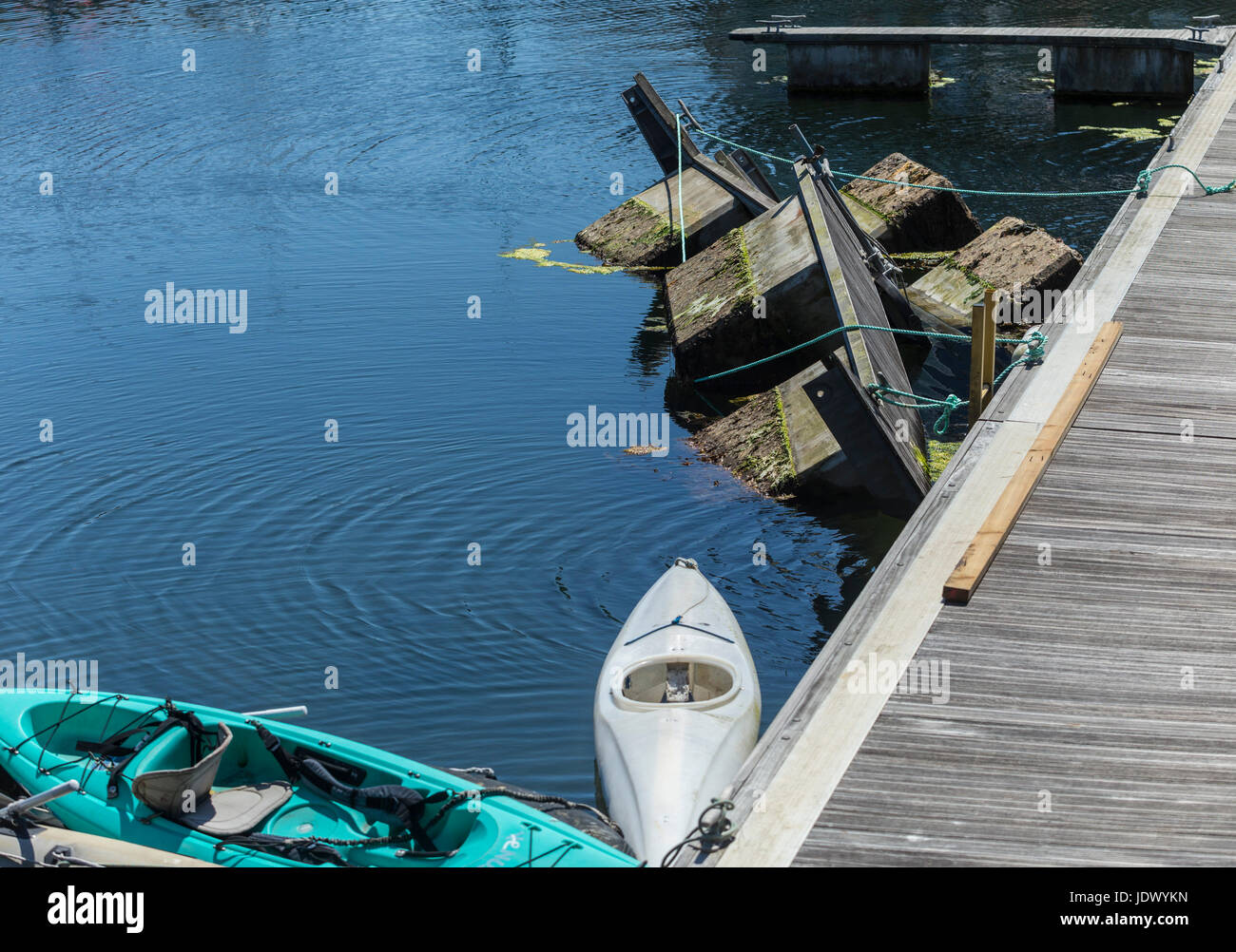 A damaged and half sunken mooring stage at Sutton Harbour, Plymouth, Stock Photo