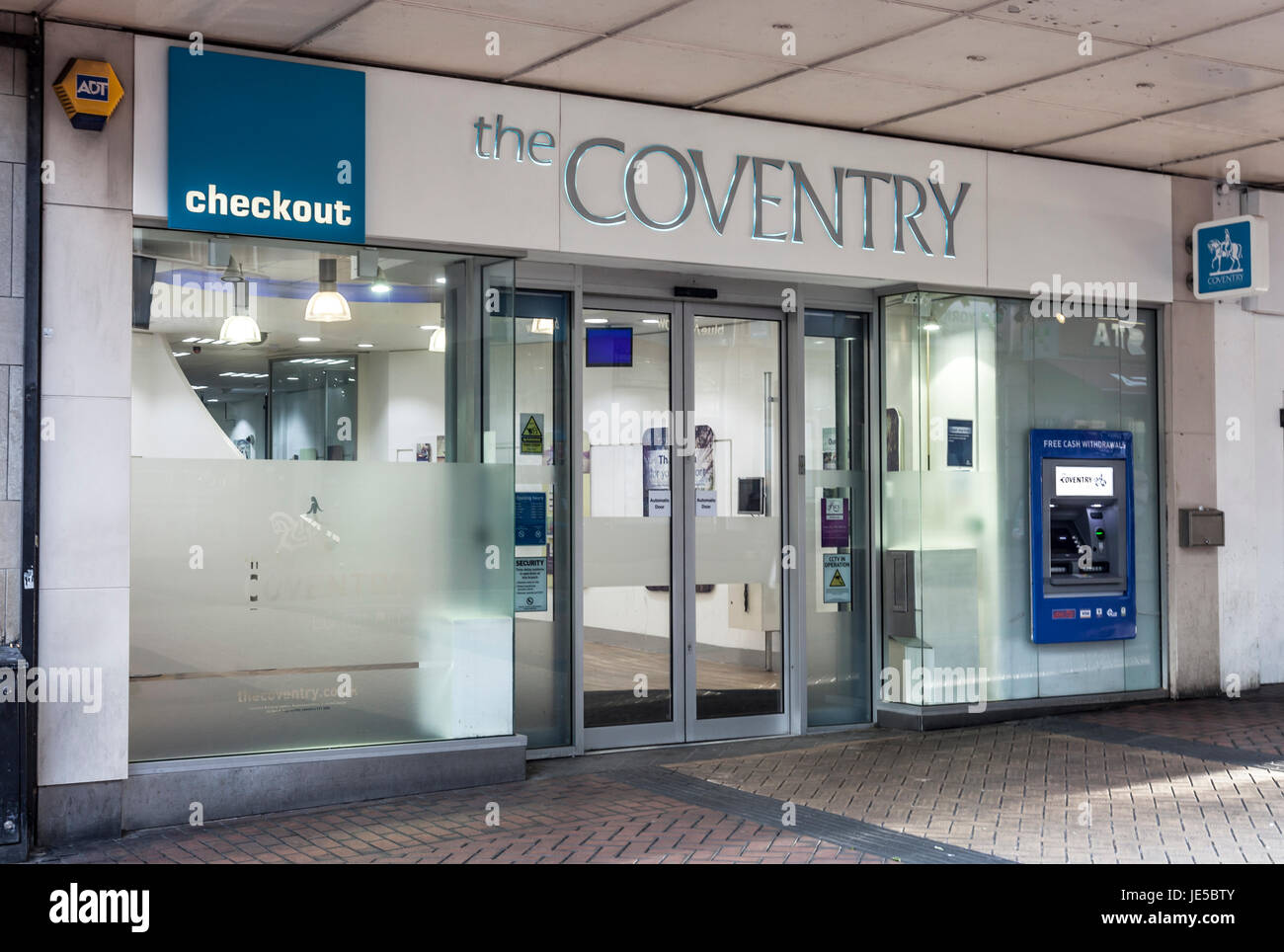 The facade, shop windows, entrance and ATM of The Coventy Building Society, in New St, Birmingham, England, UK Stock Photo