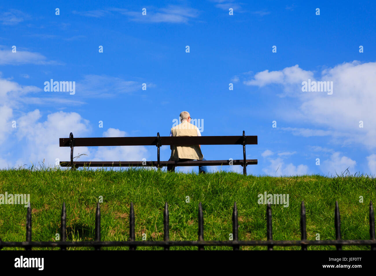 senior-citizen-resting-on-a-bench-on-the