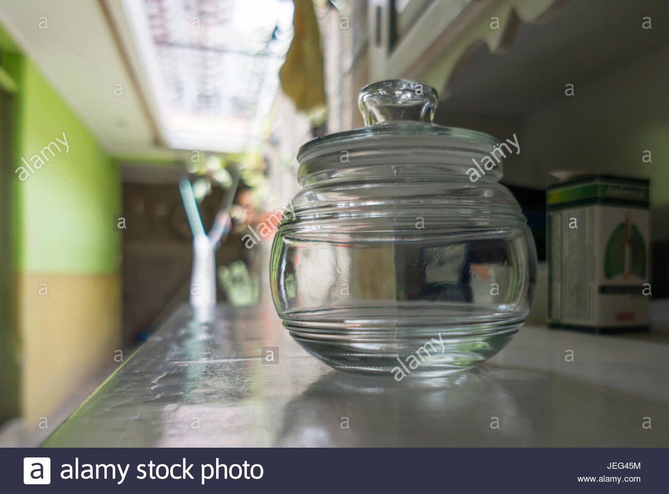 round-glass-jar-with-lid-sitting-on-a-hutch-shelf-JEG45M.jpg