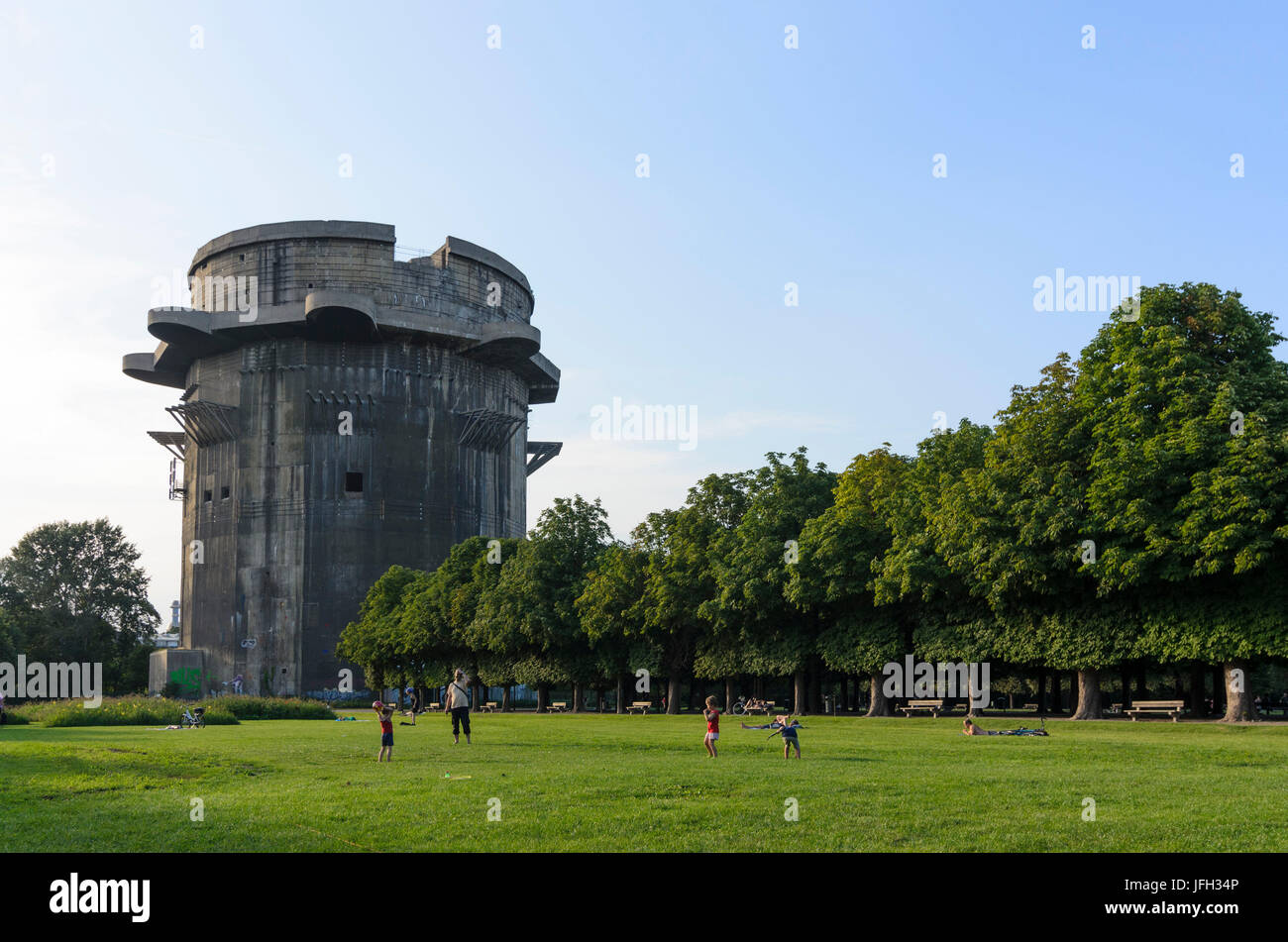 Anti-aircraft tower (battle tower) in the Augarten with having a picnic Viennese, Austria, Vienna 02. Stock Photo