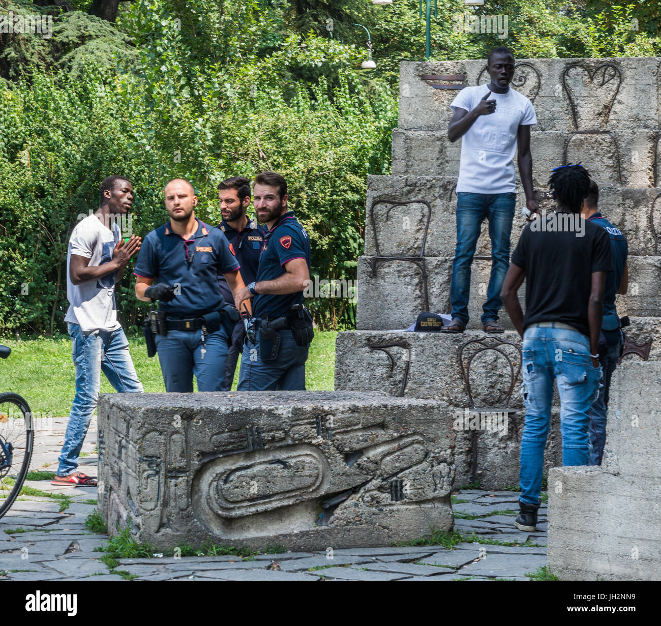 milan-italy-12th-july-2017-a-man-who-appears-to-be-a-migrant-pleads-JH2NN9.jpg