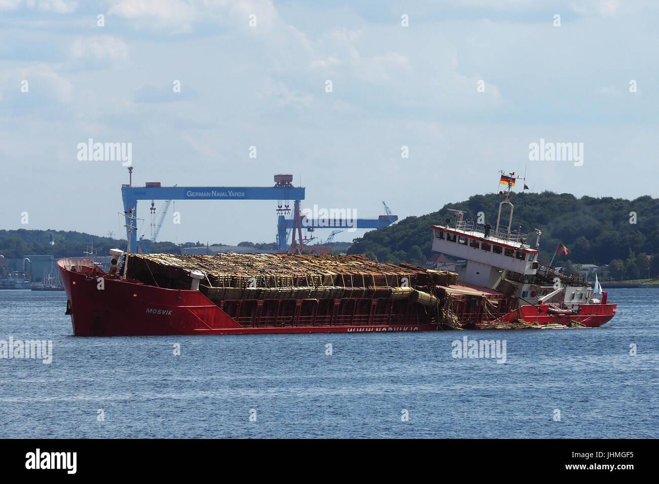 Kiel, Germany. 14th July, 2017. Genereal Cargo vessel Mosvik lost part of it`s wood-cargo while heading for the Stock Photo