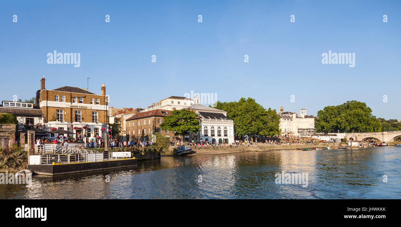 A Summer evening on the banks of the River Thames, Richmond Upon Thames, London. Walkers and customers of the WhiteStock Photo