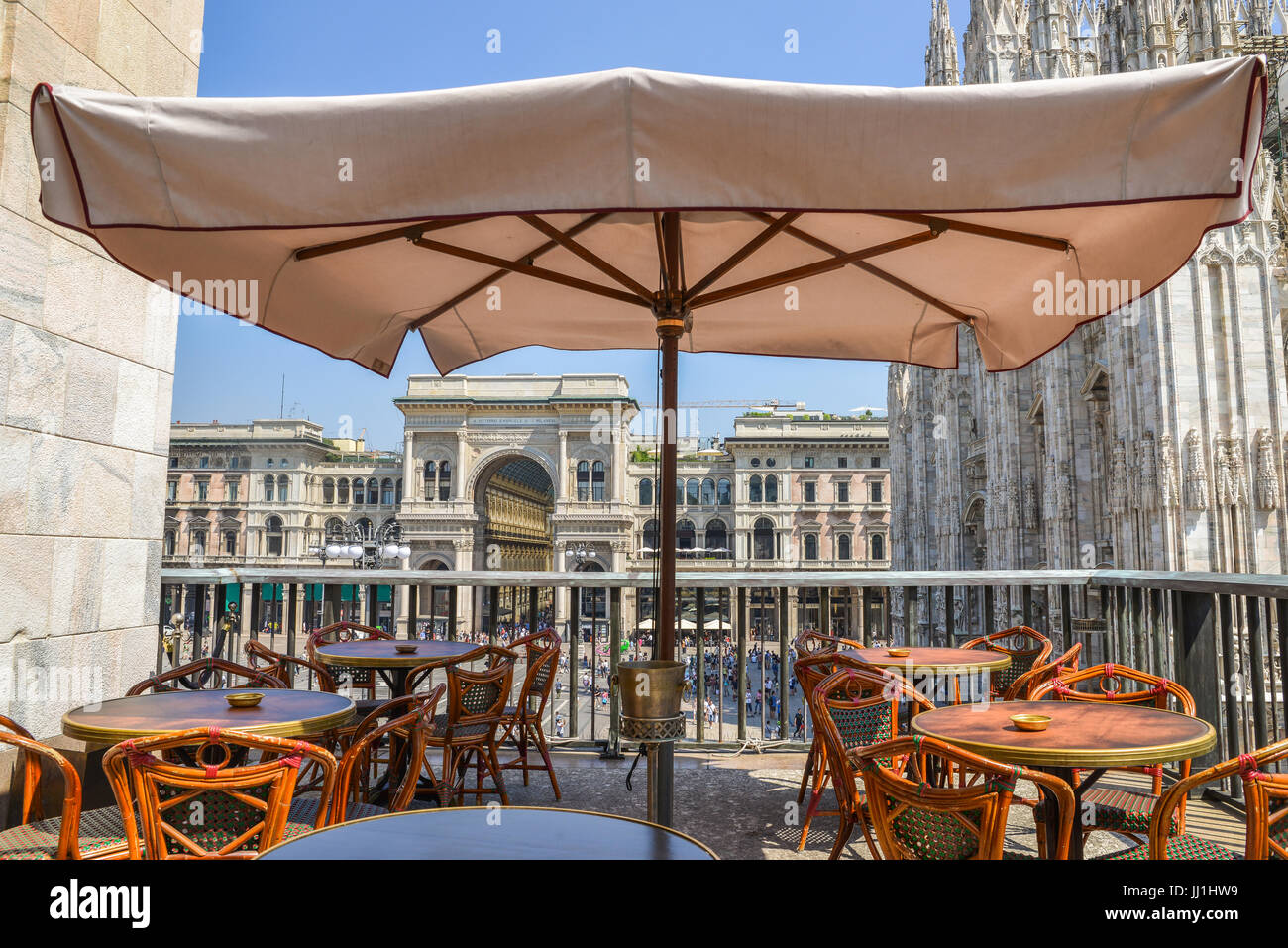 A drinks balcony overlooking Piazza Duomo in Milan, Italy on a summer day Stock Photo