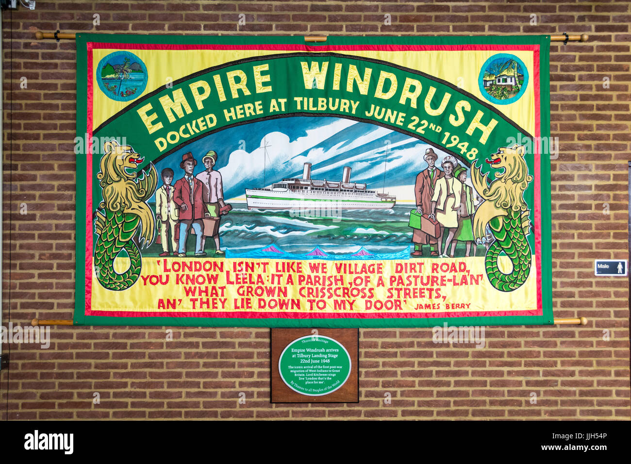 An Empire Windrush commemorative flag and plaque at the London Cruise Terminal at Tilbury Docks, Tilbury, Essex, Stock Photo
