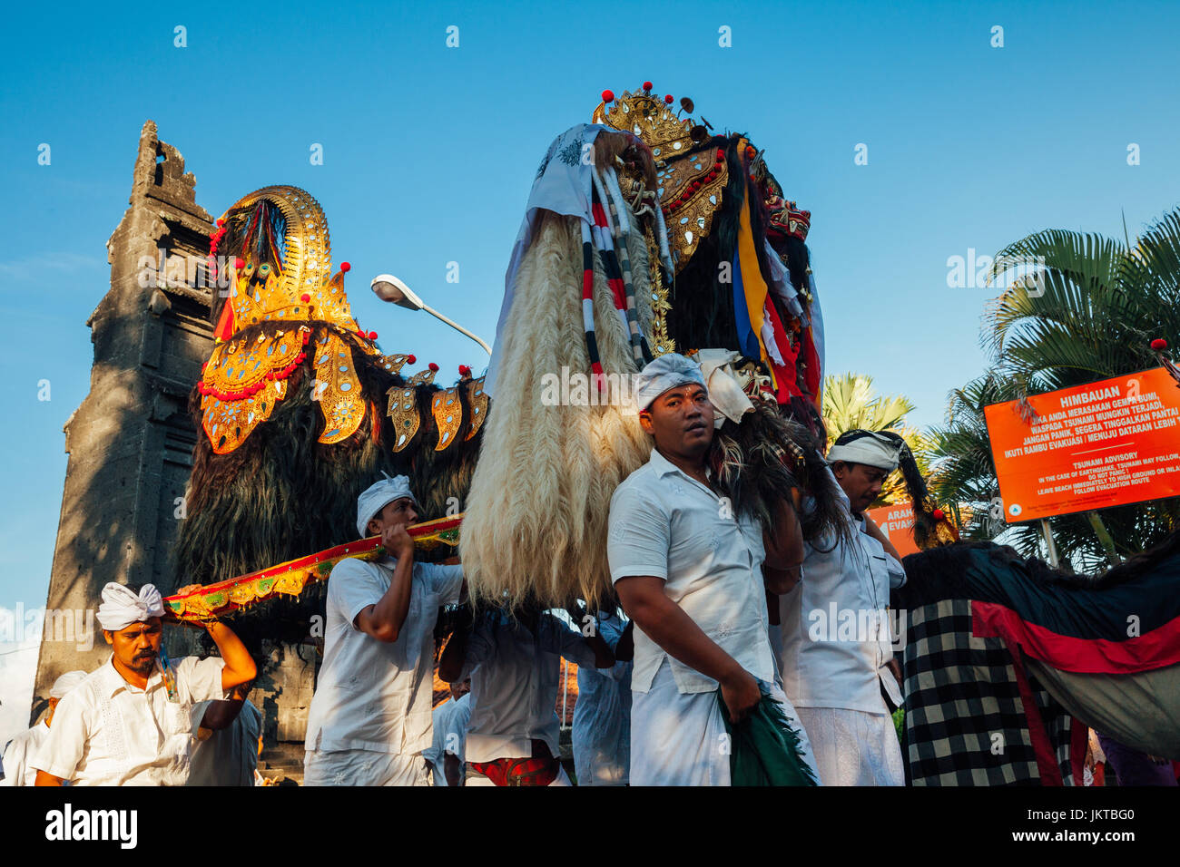 Bali, Indonesia - March 07, 2016: Balinese people in traditional clothes carry jempana or wooden litter at the procession Stock Photo