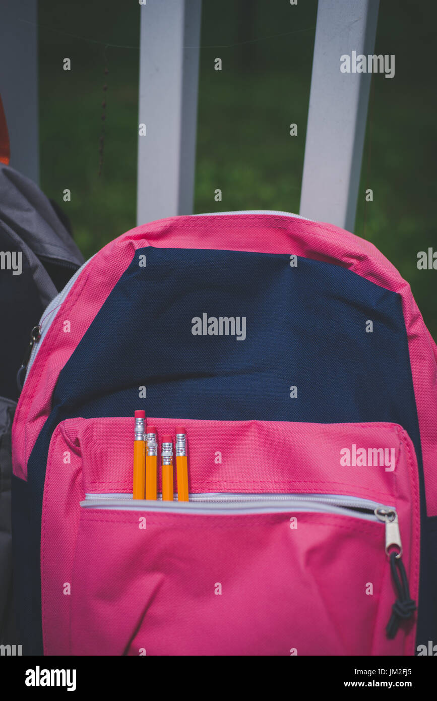 A book bag, backpack with school supplies for back to school. - Stock Image