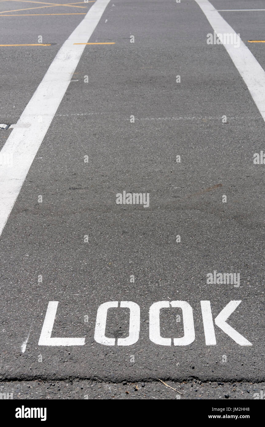 look-sign-painted-on-a-pedestrian-crossw