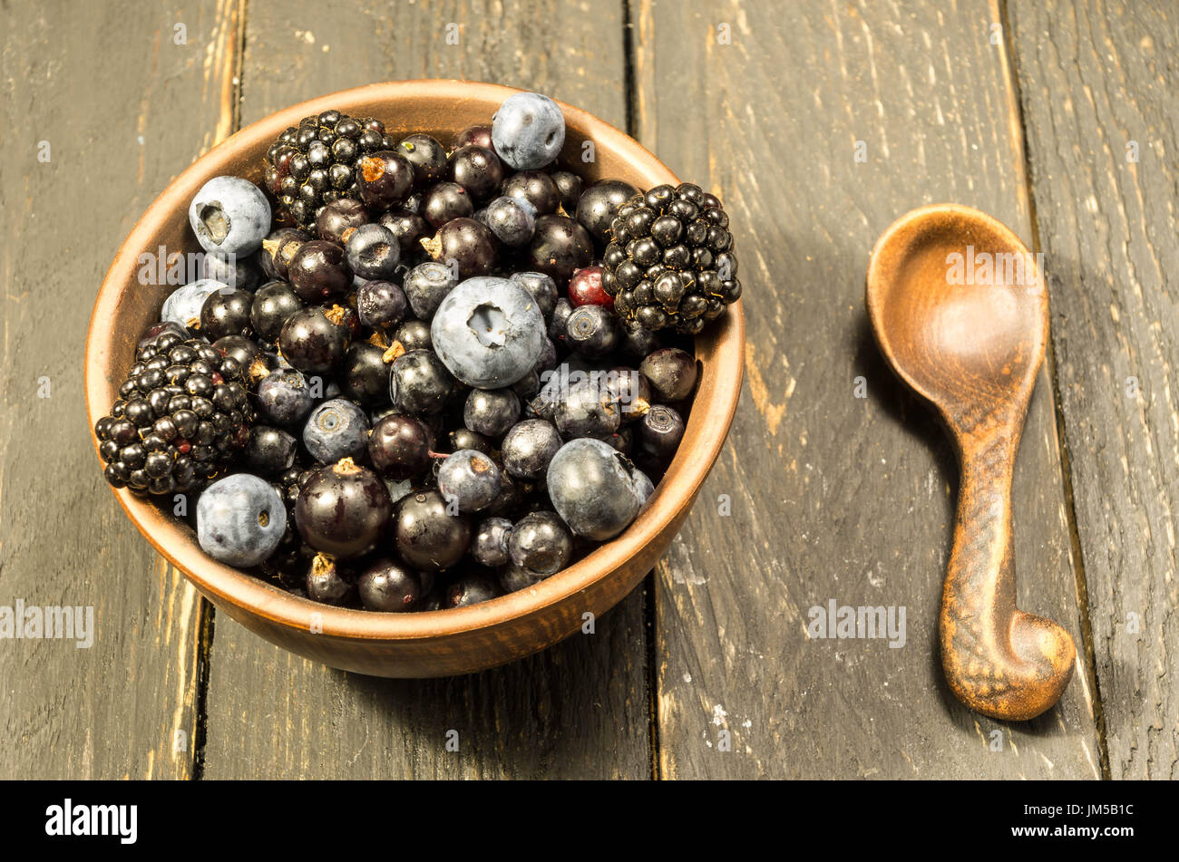 Set of pottery with forest berries. Hot mood. - Stock Image