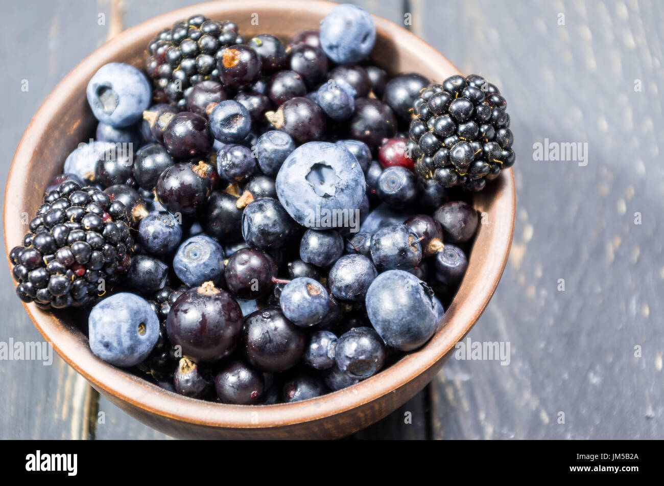 Photo of berries from close. Low depth of field. Decoration of forest berries. - Stock Image