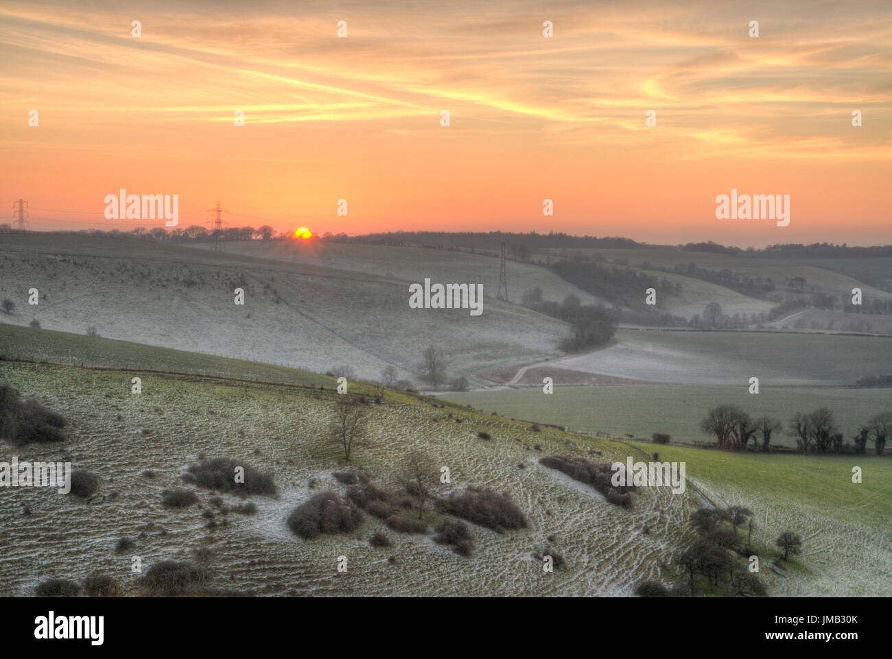Winter landscape view from Butser Hill in the South Downs National Park, Hampshire, UK at sunset Stock Photo