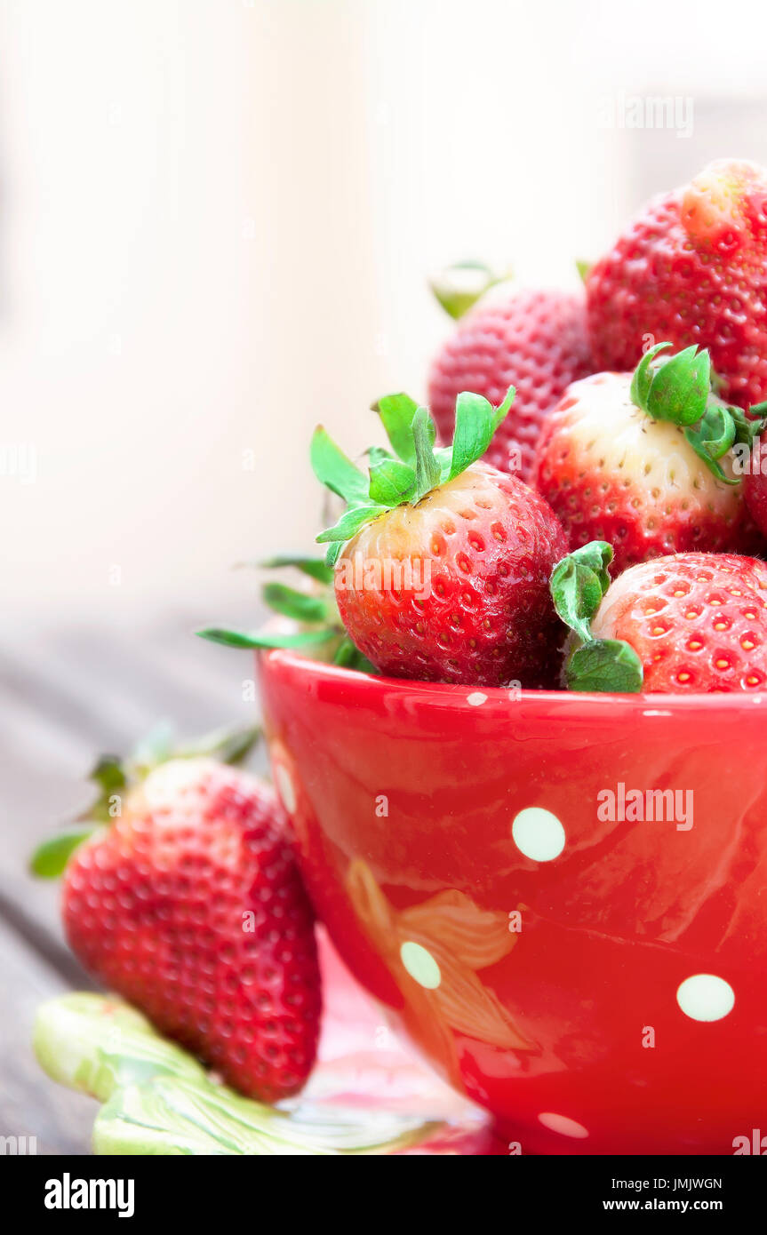 Red cup with strawberries inside - Stock Image