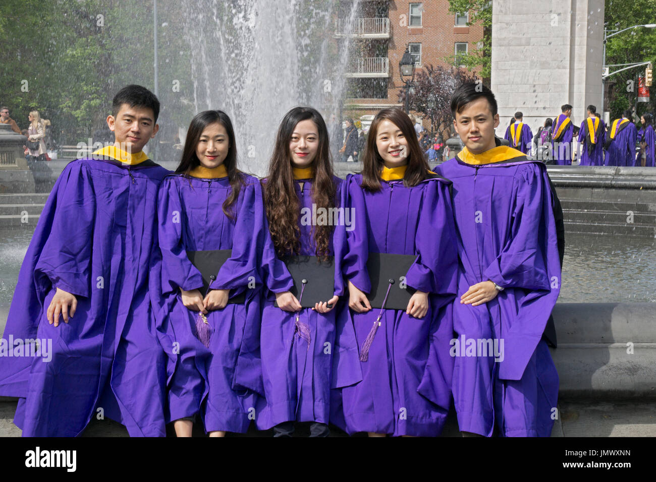 A group of Chinese students at NYU celebrating their graduation in ...