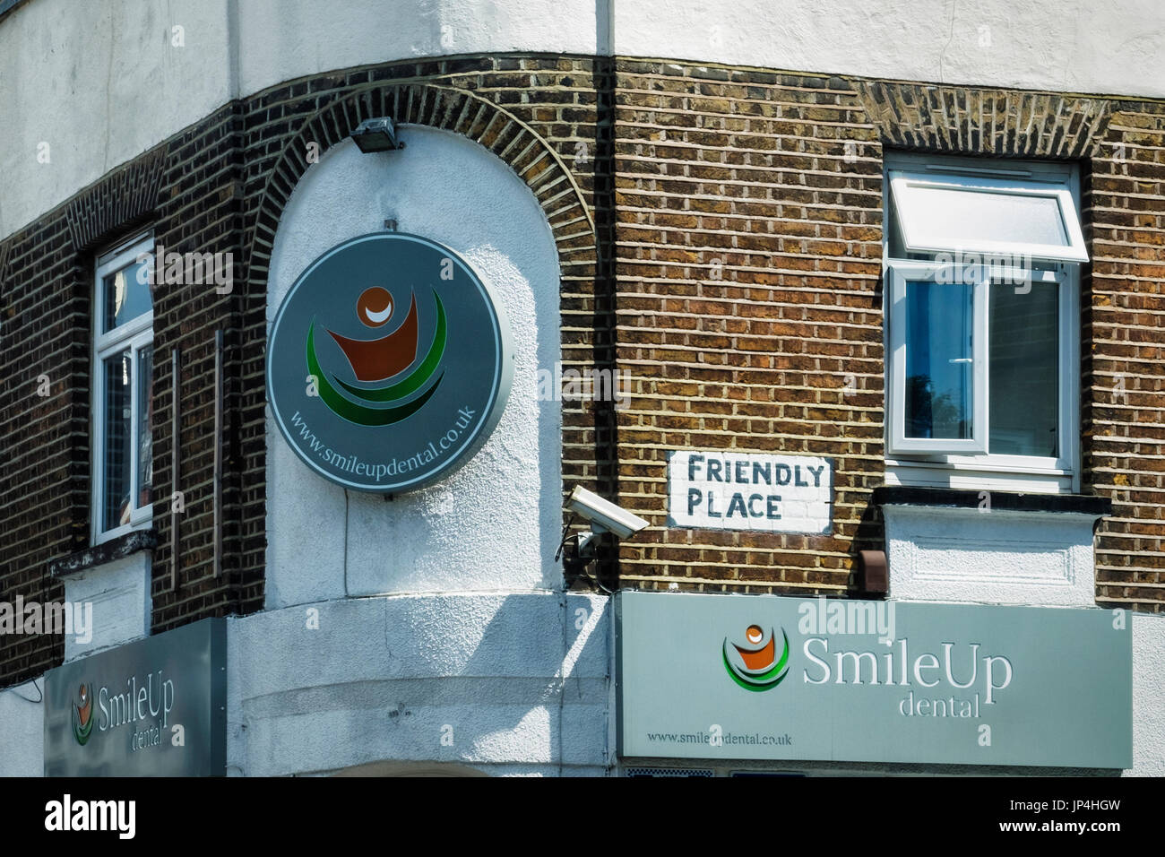Smile Up Dental Practice in aptly names street - Friendly Place. Humour,Humorous,funny,amusing - Stock Image
