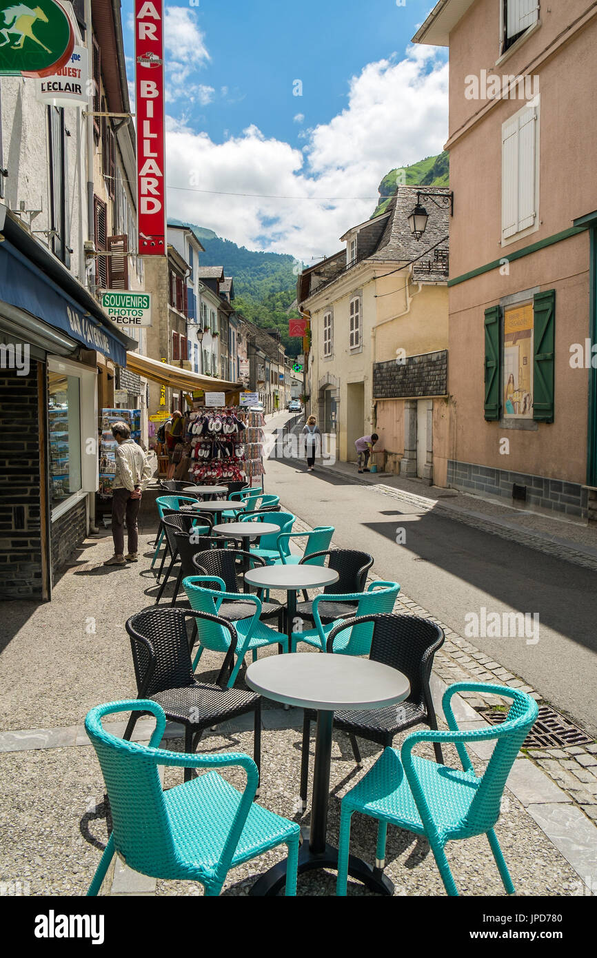Café terrace, tables and chairs - Laruns, Pyrénées-Atlantiques, France. - Stock Image
