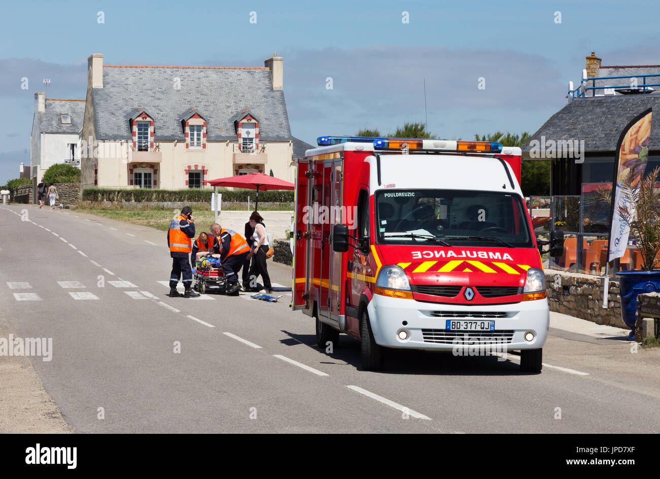 France Ambulance - a french emergency ambulance attending a road accident, Brittany, France Europe - Stock Image