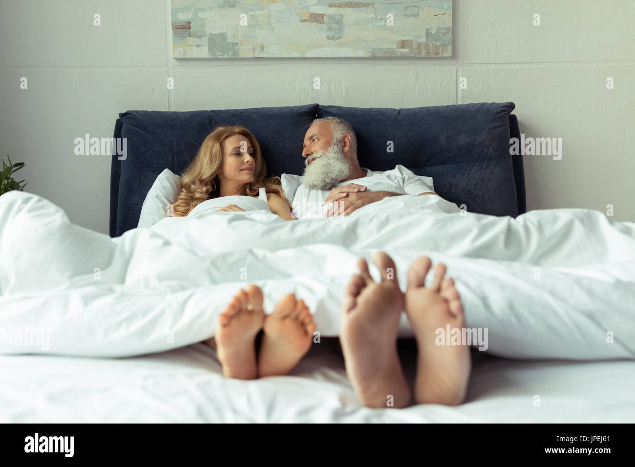 couple bed feet stock photos & couple bed feet stock images - alamy