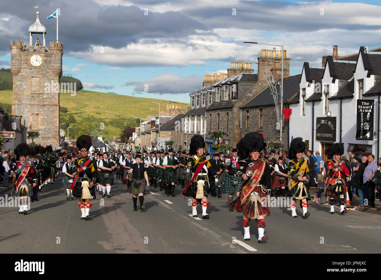 "Dufftown, Scotland - Jul 31, 2017: Massed pipe bands display ""beating the retreat"" in the town after the 2017 Highland Stock Photo"
