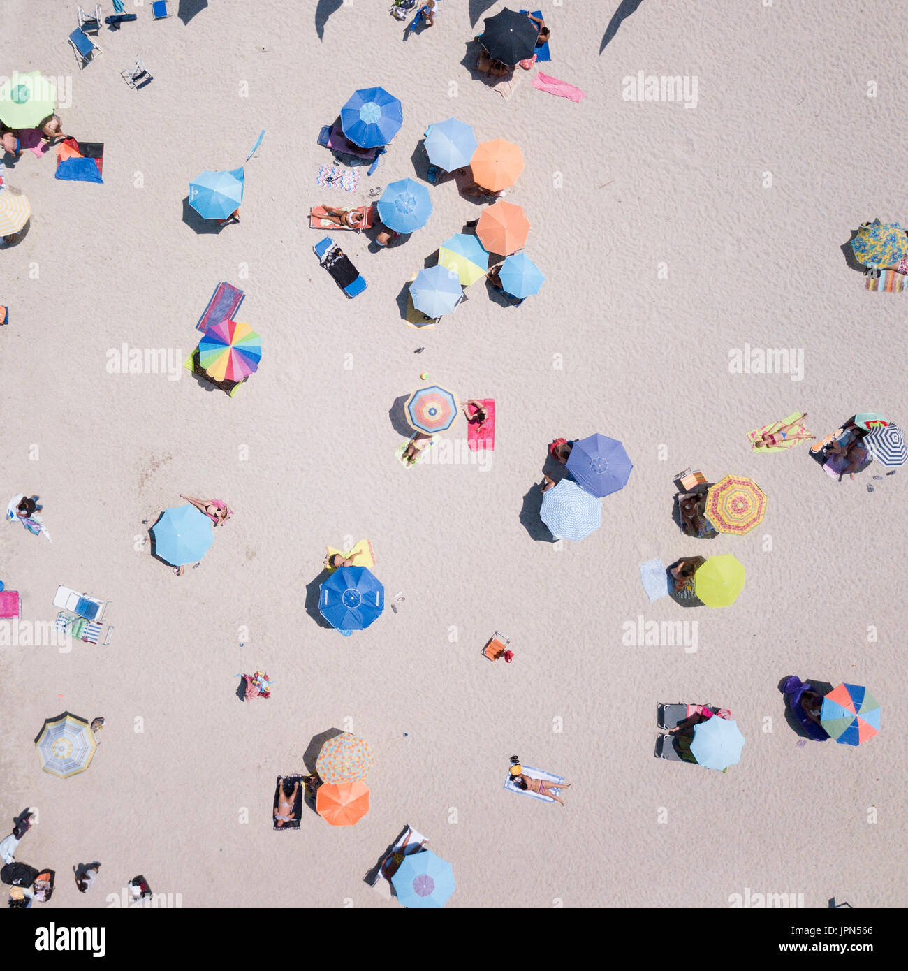 SARDINIA, ITALY, 10 JULY 2017, Aerial view of the amazing beach with colorful umbrella and people who swim. 10 JULY - Stock Image