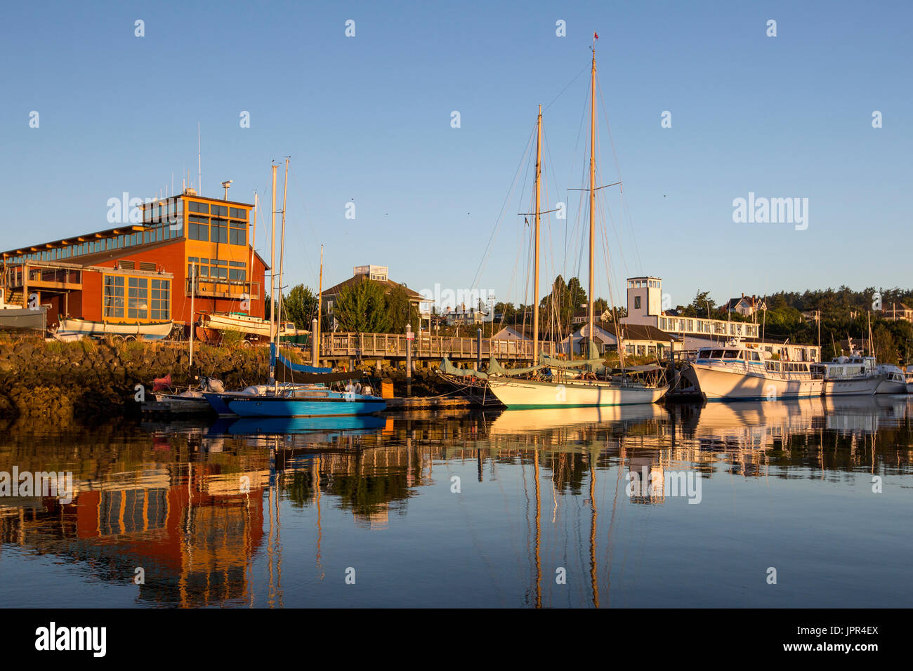 Port Townsend marina at Point Hudson with schooner sailing boat Martha during sunrise. Northwest Maritime Center - Stock Image
