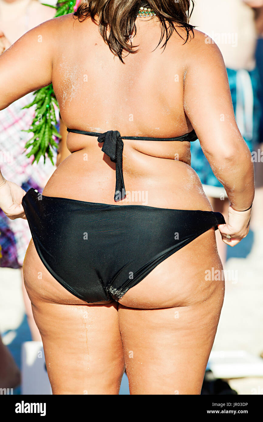 thick girl in a bikini at panama city beach, florida stock photo