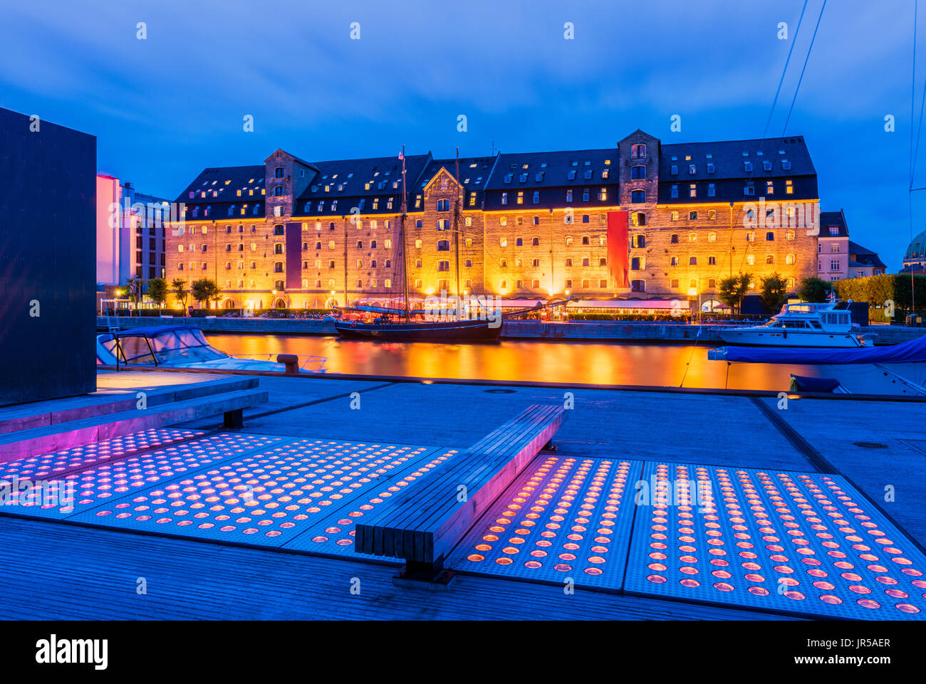 Old Quay with Modern Elements in Downtown District of Copenhagen Denmark - Stock Image