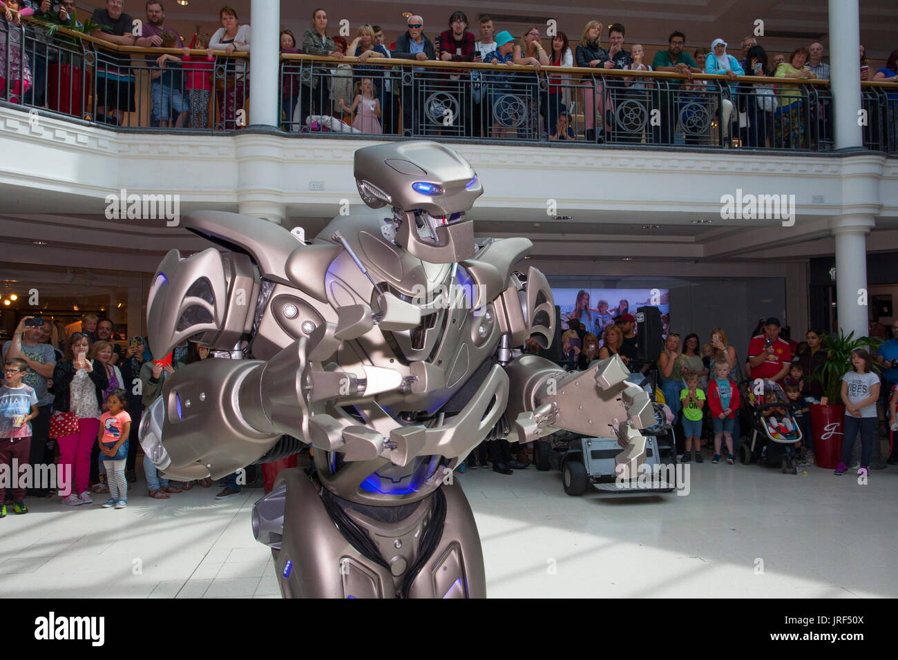Preston, Lancashire, UK. Titan the robot, wearing an exoskeleton suit, wows the crowds at St George's Centre. - Stock Image