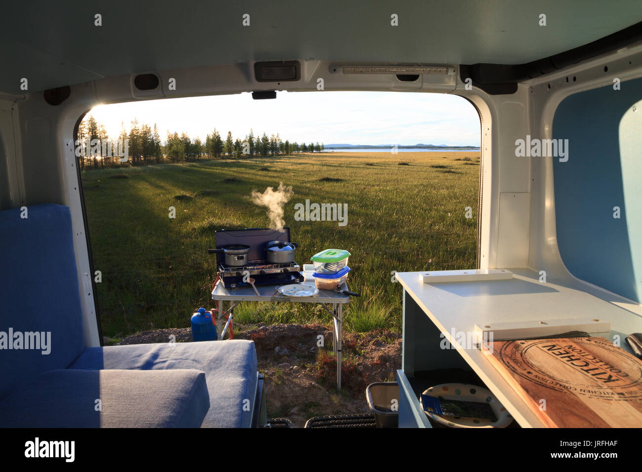 View from inside while cooking outside while free camping in a camper van - Stock Image