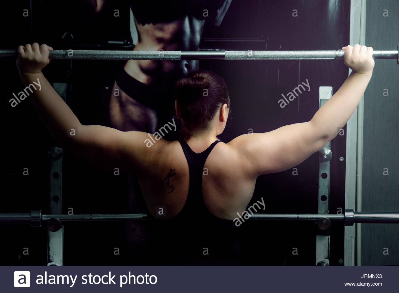 Girl in bodybuilding training - Stock Image