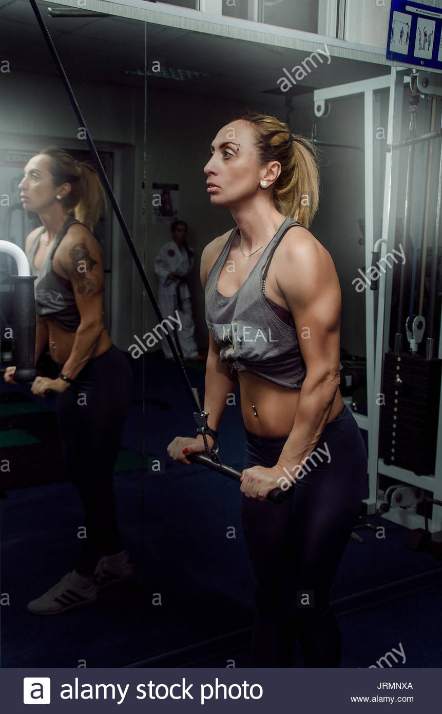 Girl in bodybuilding training Stock Photo