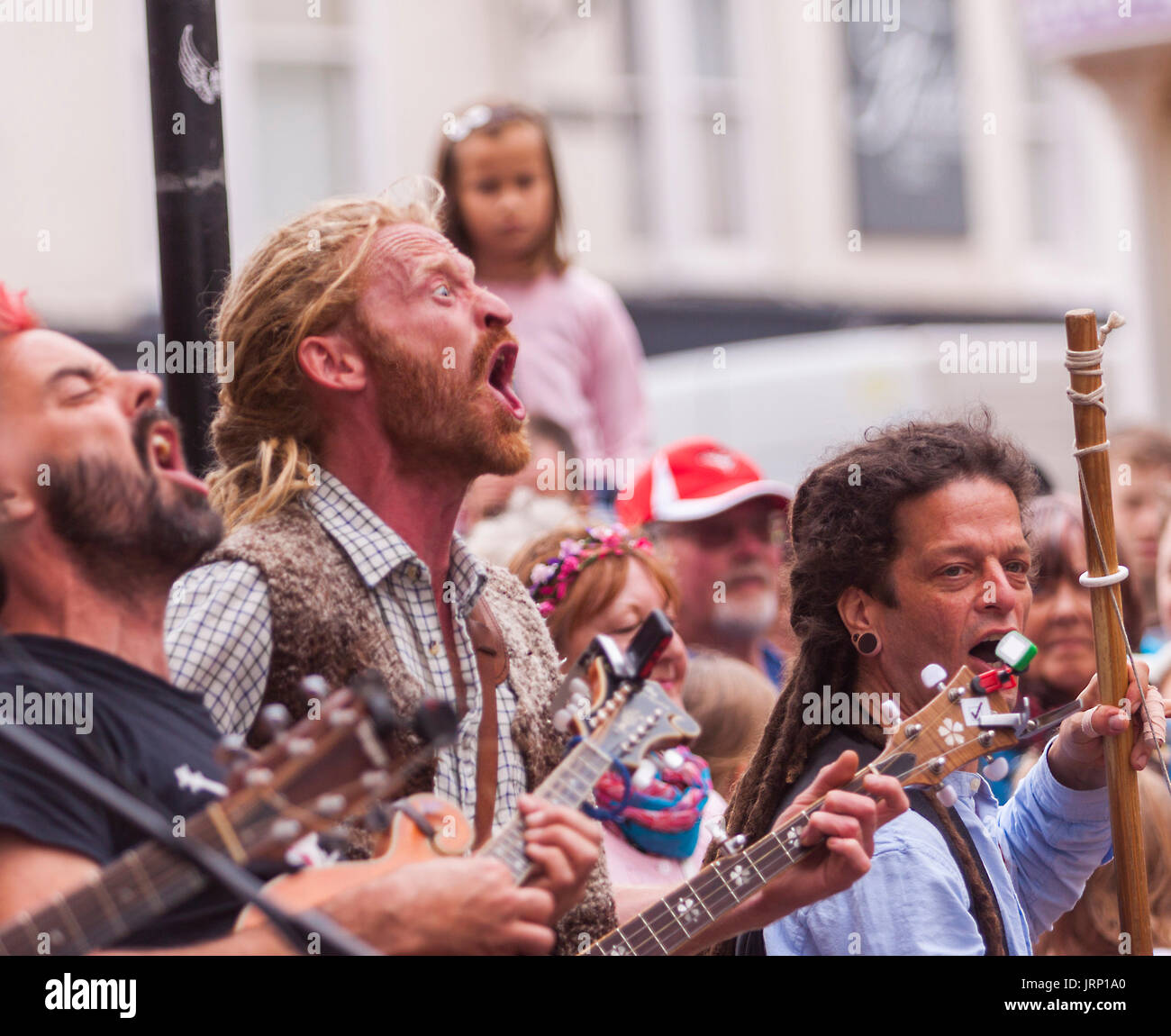 Sidmouth, UK. 6th August, 2017. Street band Phat Bollard perform in Sidmouth Market Square at the town's annual Stock Photo