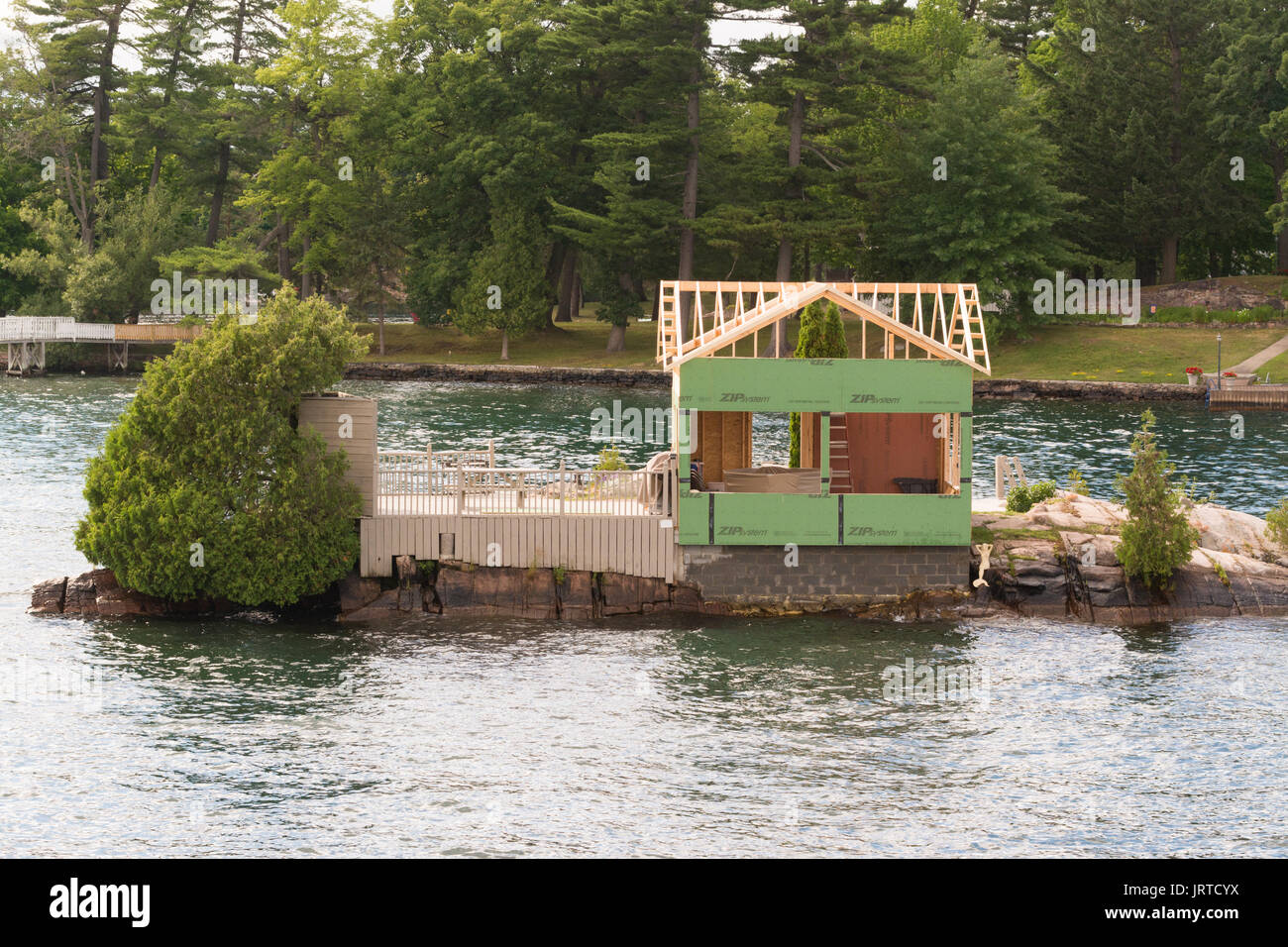 Thousand Islands new building under construction on tiny island,  Canada - Stock Image