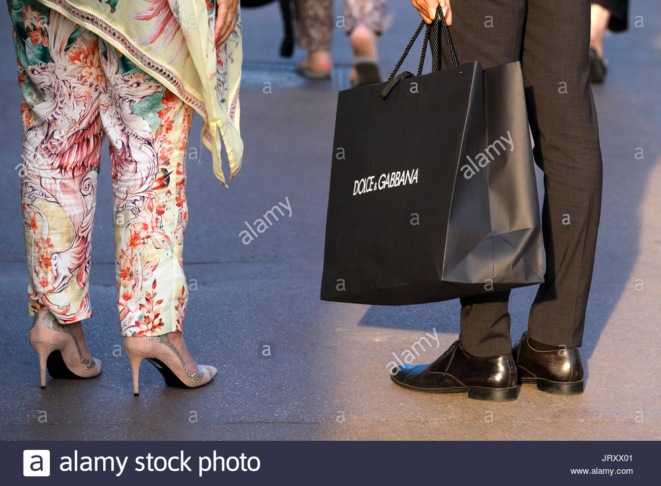 A personal assistant for the Dolci & Gabbana stoe in Cannes, France carry's a shopping bag of purchases - Stock Image