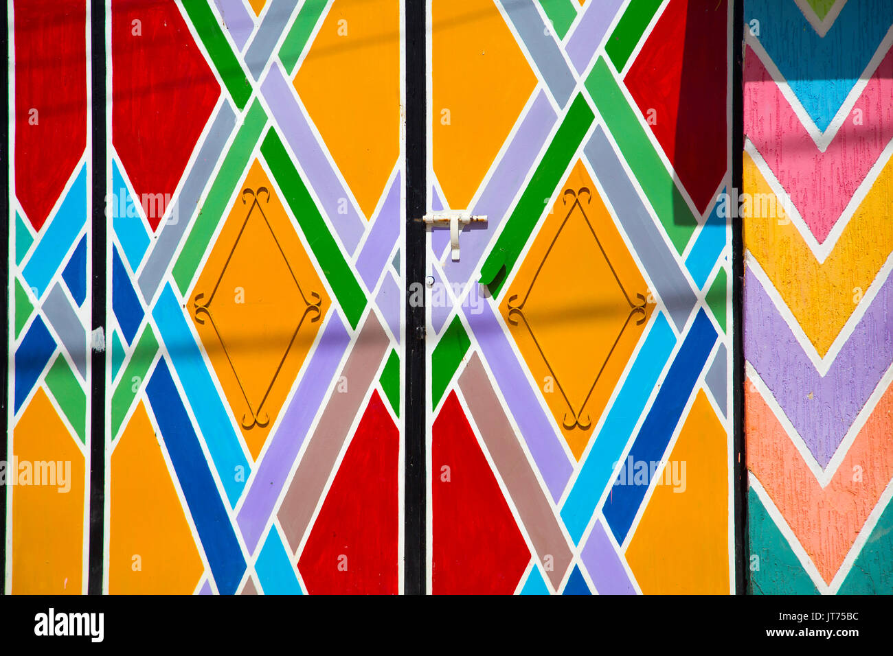 Bhalil, colored entrance door to a school. Morocco, Maghreb North Africa Stock Photo