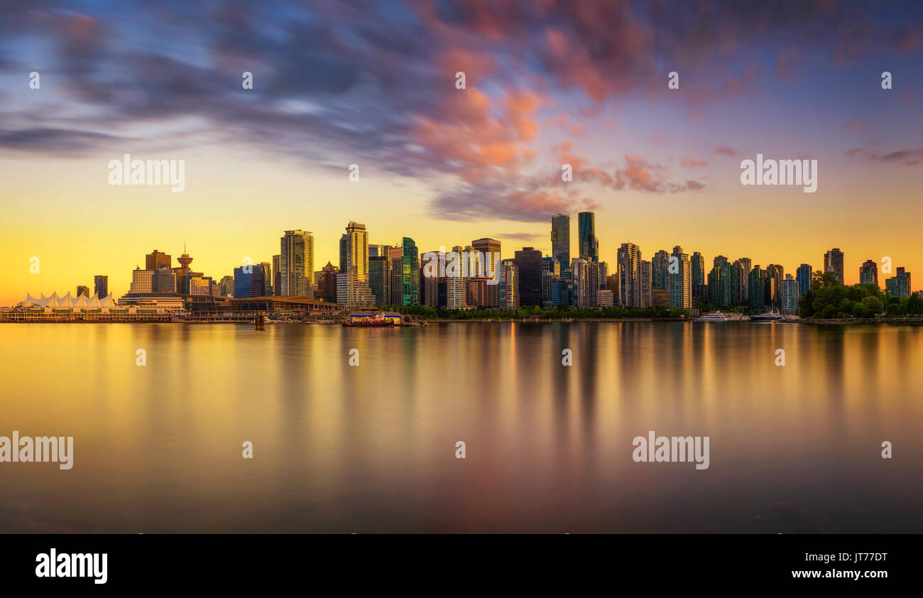 Sunset skyline of Vancouver downtown as seen from Stanley Park, British Columbia, Canada . Long exposure. - Stock Image