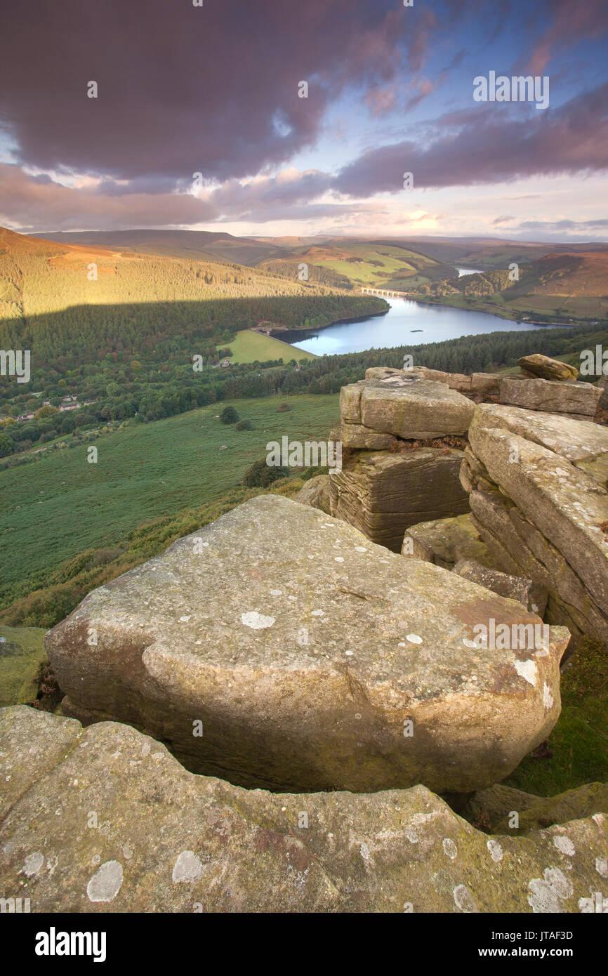 Ladybower Reservoir from the gritstone escarpment of Bamford Edge at sunrise, Bamford, Peak District, Derbyshire, - Stock Image